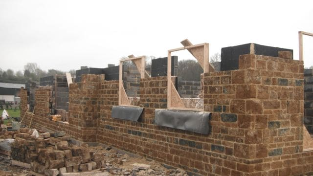ironstone-new-build-walls-with-window-frames
